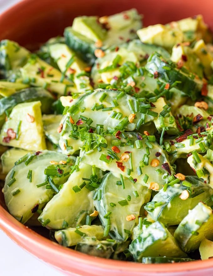close up of Cucumber Avocado Salad with creamy avocado dressing and chopped fresh chives