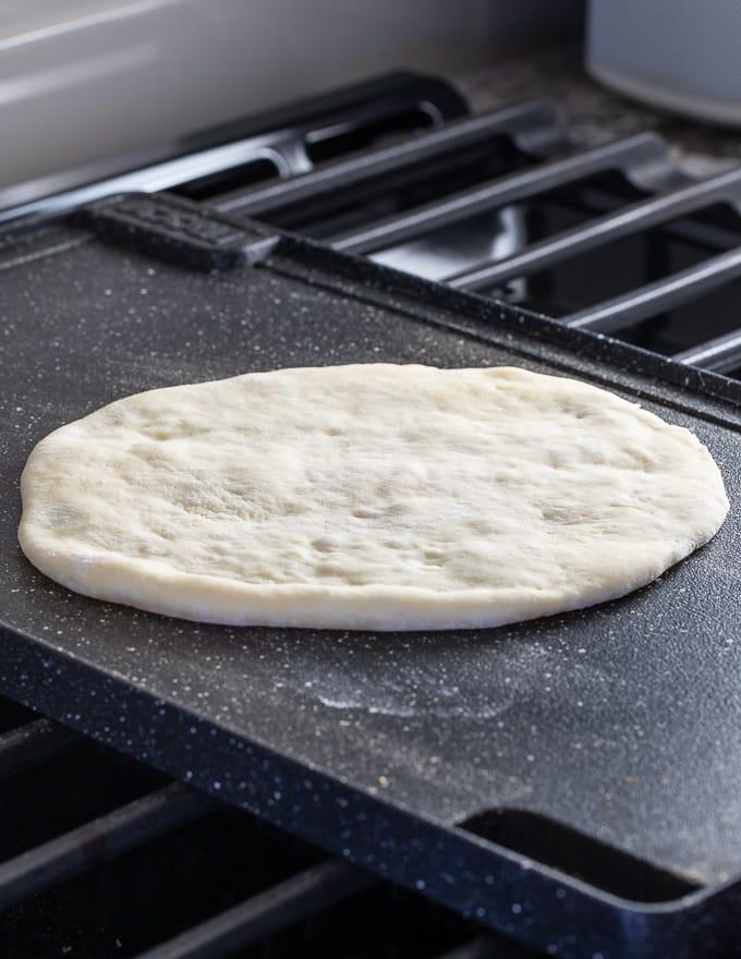 flatbread cooking on a griddle