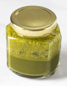 matcha and water in a jar ready to make matcha lemonade