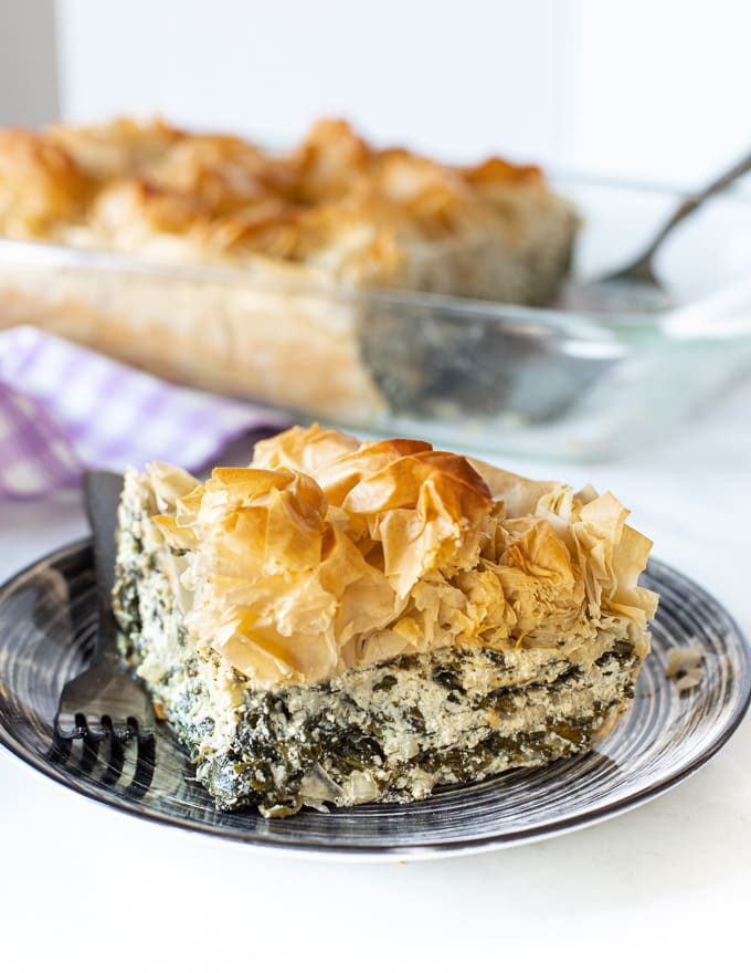 a slice of vegan spanakopita on a plate