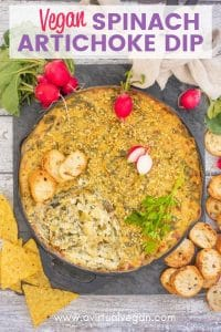 Warm, soft, rich and creamy Vegan Spinach Artichoke Dip. Chock full of spinach and briny, zesty artichokes and full of flavour. Just perfect for serving on game day or at parties, or for indulging in on a treat yo'self kind of night! Amazing served warm but also good at room temperature.