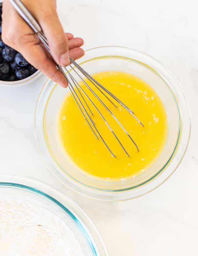 whisking wet ingredients for giant blueberry vegan pancake