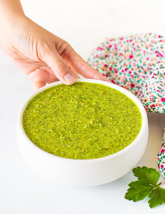 green sauce in a white bowl
