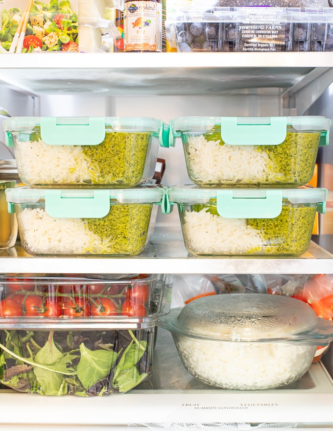 stacked vegan meal prep containers in the fridge