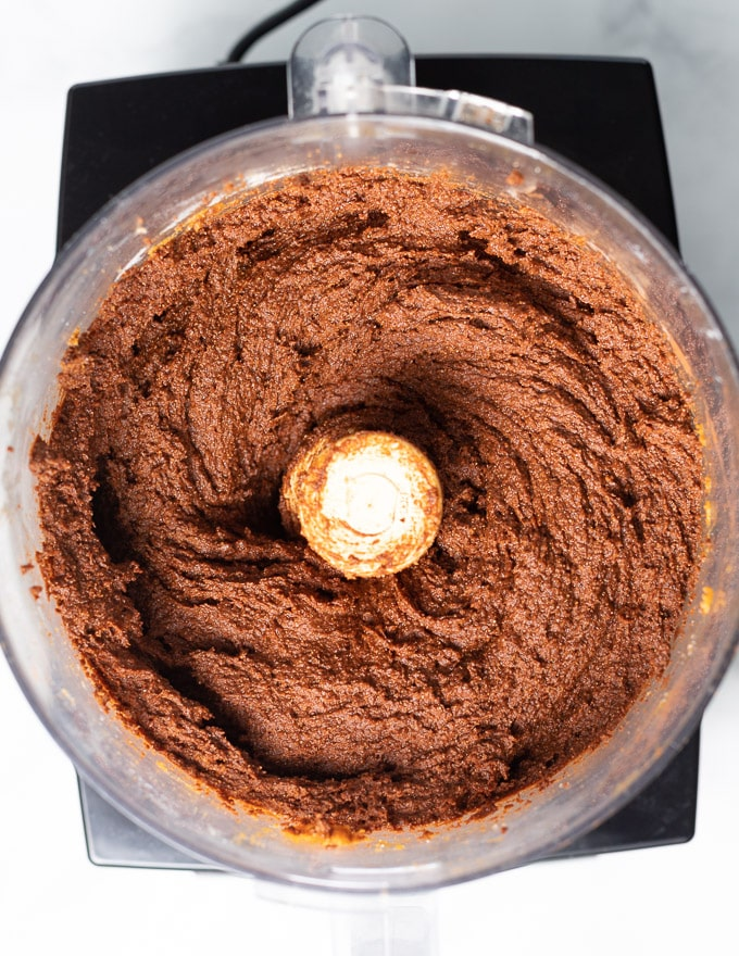 making double chocolate pumpkin muffin batter in a food processor