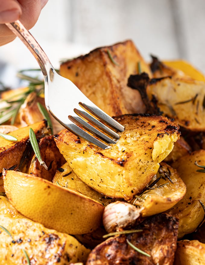 close up of fork in air fryer roasted roast potato