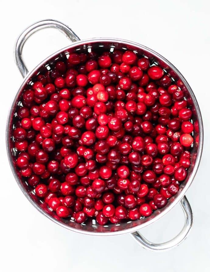 a colander of fresh cranberries