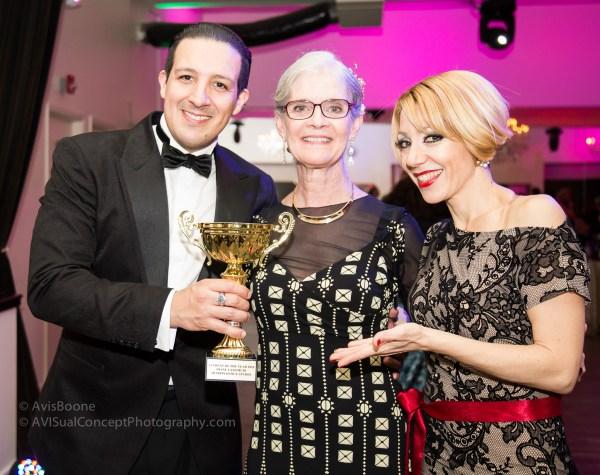 Analia & Luis Ramirez present Diane (c) with an award
