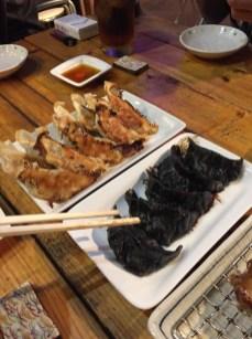 the regular gyoza and ikasumi gyoza (squid-ink gyoza)