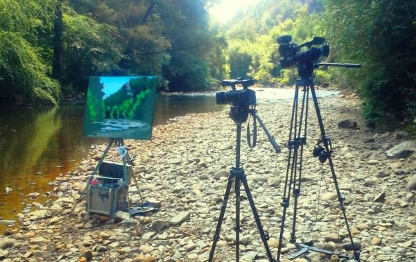 Painting DVD shoot day 1 shows a half painted canvas alongside the Avoca River.