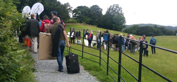 Wild card artists, each with their studio in tow, climb the hill to Wray Castle.
