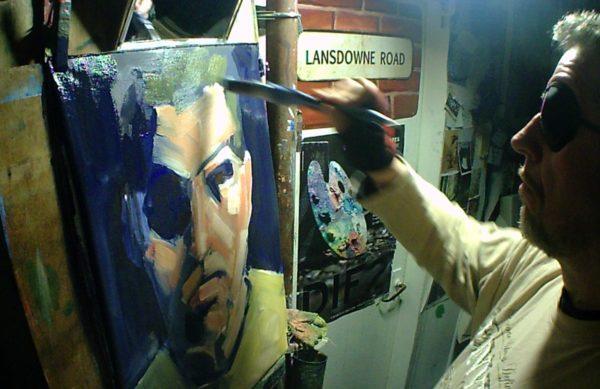 Rod Coyne paints a self-portrait method wearing an eyepatch.
