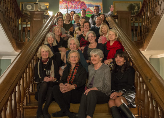 Twenty six artists seated on the grand staircase.