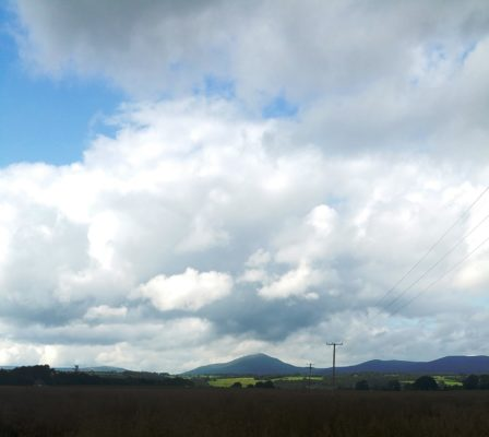 Knockmealdown mountains loom large and majestic on the horizon.