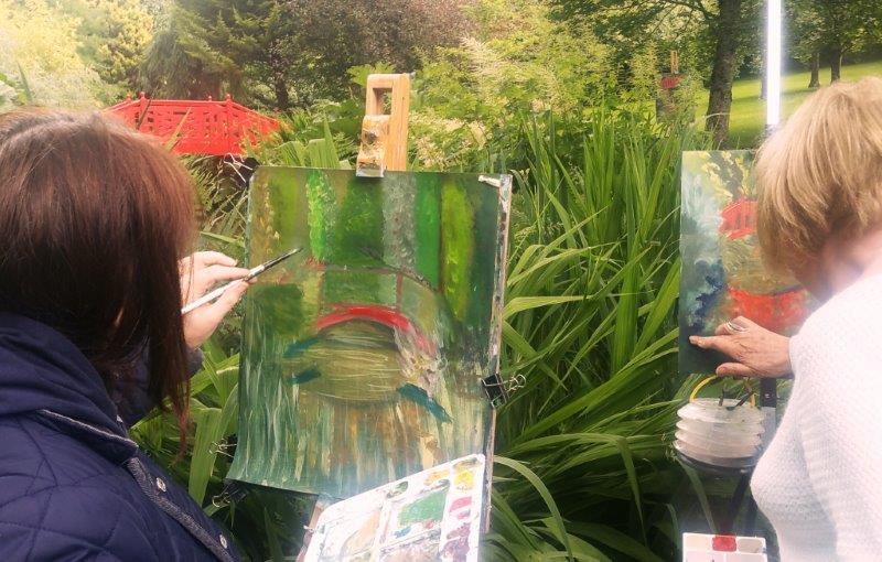 The bridge splashes red in to a see of green at last summer's Knocknaree Painting Workshop.