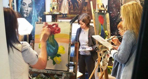 Art students paint still life.