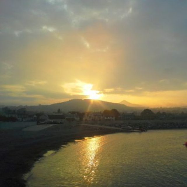 Amazing sunset over the Sugarloaf Mountain looking inland from Greystones Harbour.