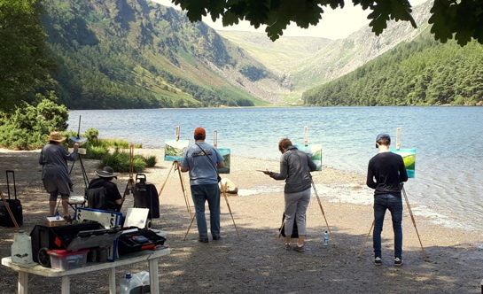 Painting students working on the shores of Glendalough Lake, just one venue in the Painting Holiday 2018.