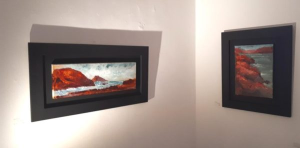 "The artist's experimentation with framing as well as his painting palette paid off and the black mounts drew universal acclaim. These two canvases are ""Crimson Lady's Ruff"" 30x60cm and ""Tierra del Fuego"" 30x40cm."