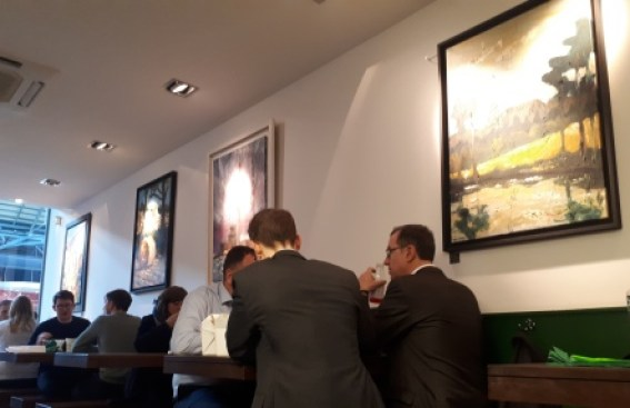 Photo of Diners from Dublin's Financial Centre surrounded by Rod Coyne's singular contemporary paintings.