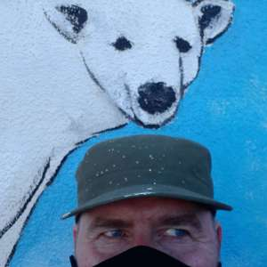 Close up photo shows Eco Aware Banksy Bears peers down at his creator Rod Coyne.