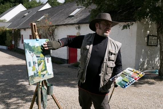 Rod Coyne explains techniques through painting demonstration.
