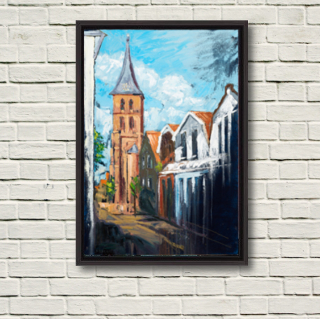 """Image of """"Domburg Mandriaan's Church"""" canvas print in black frame displayed on a rough white wall."""