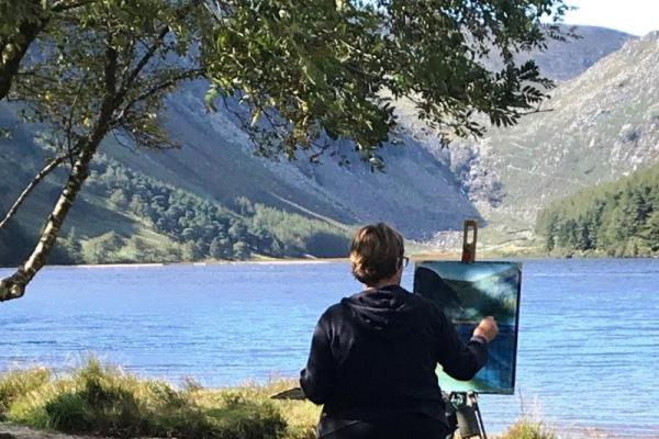 Photo dpicting a student makes the finishing touches at the end of a successful day's work from our Painting Workshop at Glendalough in 2019.