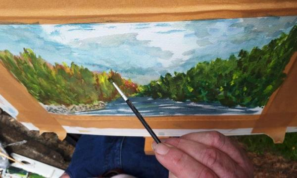 Photo of a student working in water colour during our August Painting Workshop in 2019.