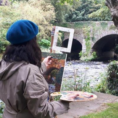 Photo depicting a student using a view finder to create a balanced composition from the June Painting Workshop in 2019.