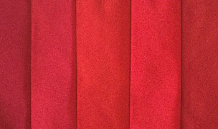 shades of red fabric swatches
