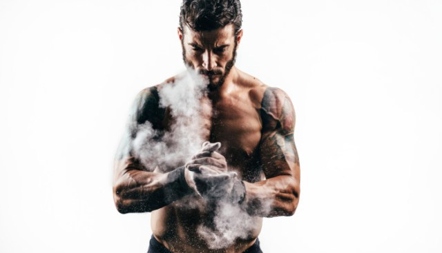 Portrait of a man with perfect muscular built. Man is good looking. He is wearing a beard.