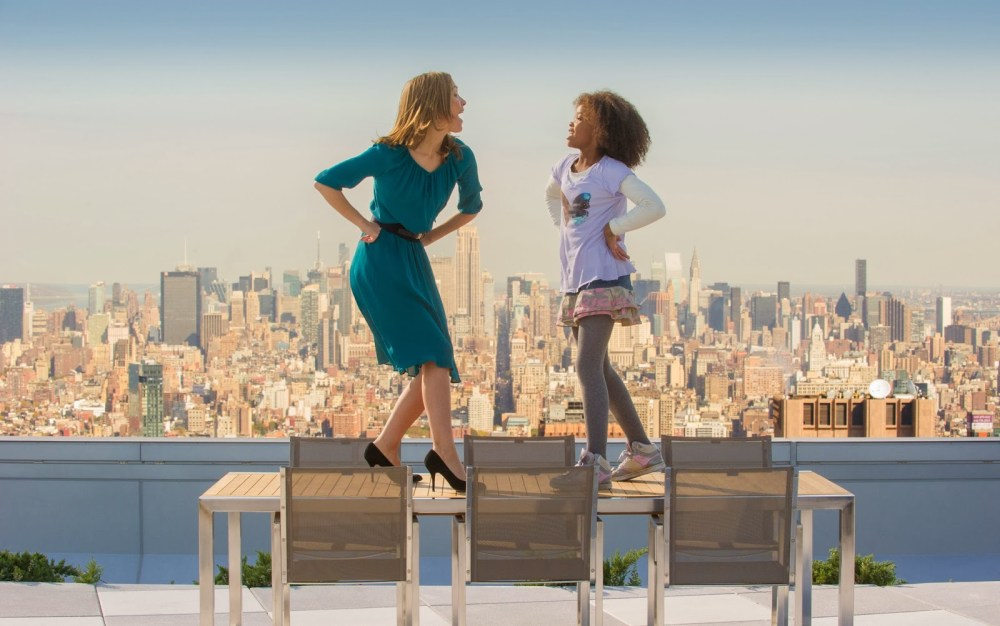 Rose Byrne and Quvenzhané Wallis are on top of the world in Annie (2014)