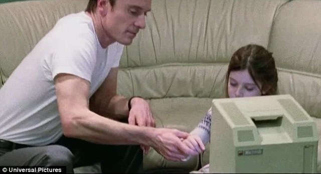 Michael Fassbender as Steve Jobs, sharing a moment with his daughter Lisa and the new Apple computer...Lisa.