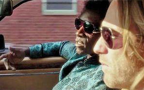 Miles Davis (Don Cheadle) has some words for (Ewan McGregor)