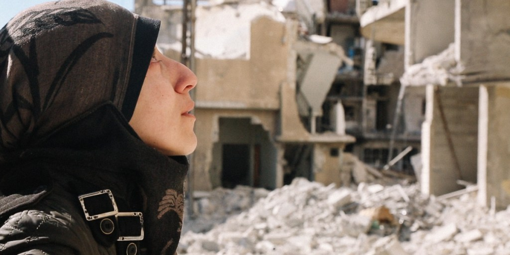 Al Ghouta, Syria - Dr Amani amongst rubble. (National Geographic)