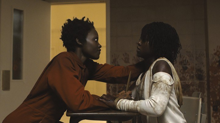 Doppelgänger Red (Lupita Nyong'o) and Adelaide Wilson (Lupita Nyong'o) in Us, written, produced and directed by Jordan Peele.