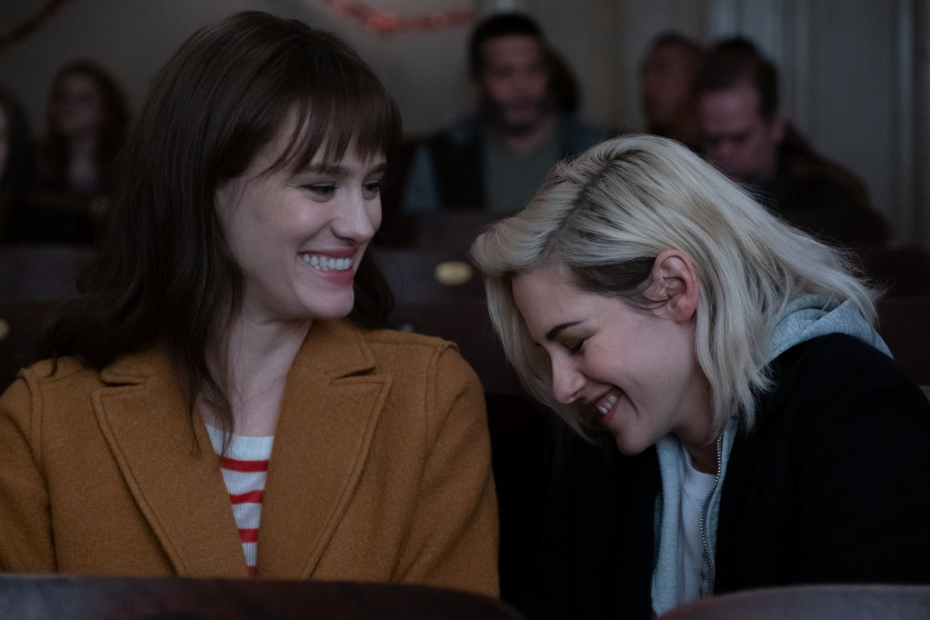 Abby (KRISTEN STEWART, right) and Harper (MACKENZIE DAVIS)  enjoy a moment at the movies in TriStar Pictures' romantic comedy HAPPIEST SEASON.