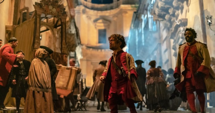 C_06888_RC Peter Dinklage stars as Cyrano and Bashir Salahuddin as Le Bret in Joe Wright's CYRANO A Metro Goldwyn Mayer Pictures film Photo credit: Peter Mountain © 2021 Metro-Goldwyn-Mayer Pictures Inc. All Rights Reserved.