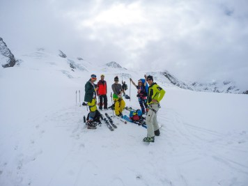 At the bottom of the upper glacier we had to strap to skins.