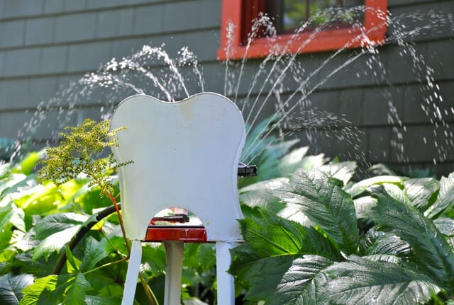 sprinkler on stool
