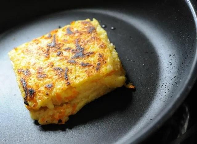 polenta cake crisping in frypan