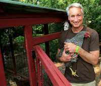Joe Lamp'l with one of his backyard chickens (Growing a Greener World TV photo).