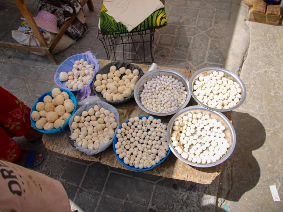 Qurut balls at the market in Samarand. One kind of Uzbek food we did not like as much!