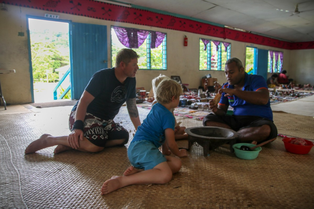 Trying kava in Fiji with the kids.