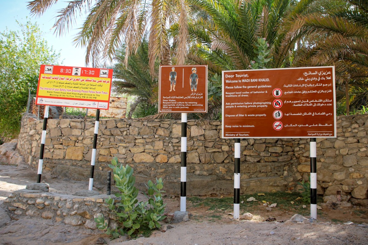 Signs at Wadi Bani Khalid, in Oman. What to wear in Oman.