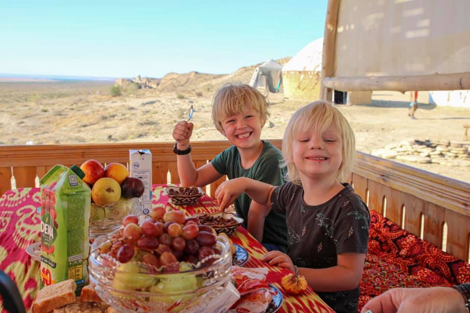 Breakfast at the Aral Sea with kids. Travel in Uzbekistan with kids.