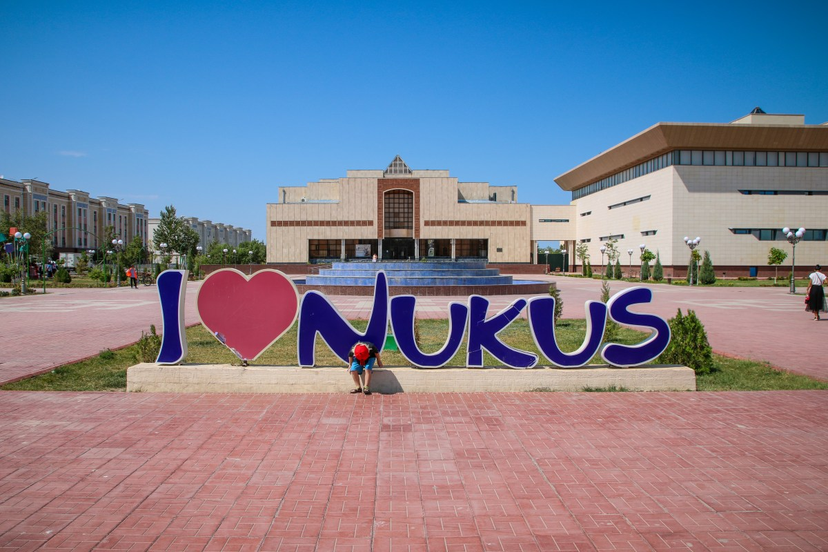 """Visiting the museum in Karakalpakstan after arriving by train to Nukus. Sign saying """"I Love Nukus""""."""