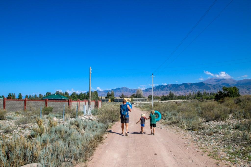 Kyrgyzstan with kids, swimming in Lake Issyk Kul in summer.