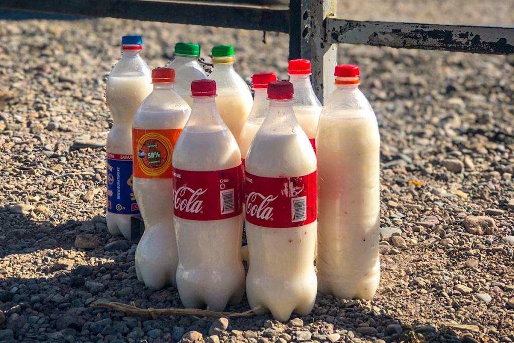 Bottles of Kymyz for sale in repurposed coke bottles. Kymyz is fermented mares milk in Kyrgyzstan and Kazakhstan.